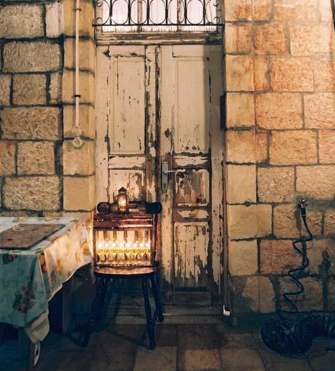 The chanukiah is placed in the doorway opposite the mezuzah